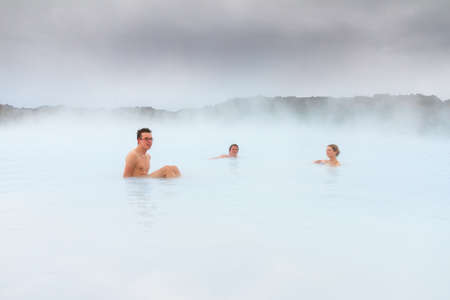 healing: Sick people healing in the blue mineral waters of a geothermal spa in Iceland
