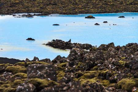lava field: Blue lagoon waters in the lava field landscape of Iceland in winter Stock Photo