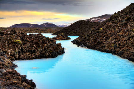 lava field: Blue lagoon waters in the lava field landscape of Iceland in winter, HDR Stock Photo