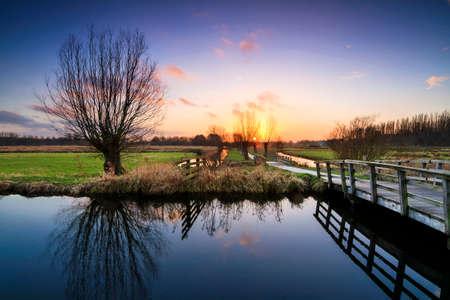 polder: Beautiful sunset in polder park Cronesteyn in Leiden, the Netherlands. Stock Photo