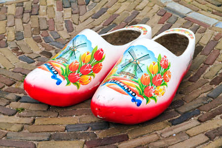 dutch typical: Typical dutch wooden clogs klompen, painted with tulips and a windmill Stock Photo