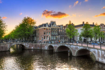 river       water: Beautiful sunset at the Emperors canal Keizersgracht canal in Amsterdam and Leiden in spring