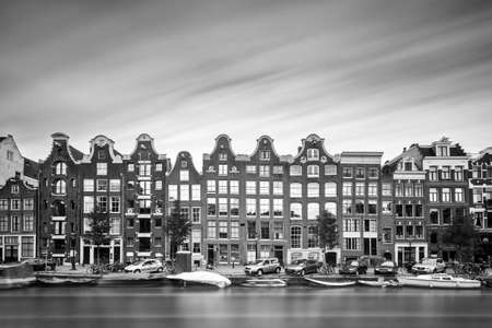 the world heritage: Beautiful long exposure of the canal houses at the UNESCO world heritage Prinsengracht canal in Amsterdam in black and white