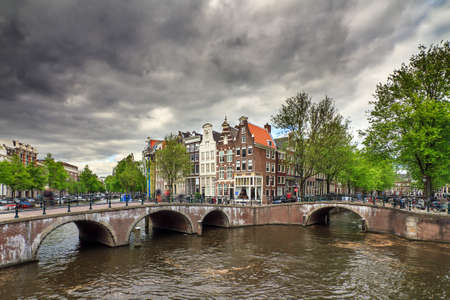 emperors: Beautiful clouds at the Emperors canal Keizersgracht canal in Amsterdam and Leiden in spring