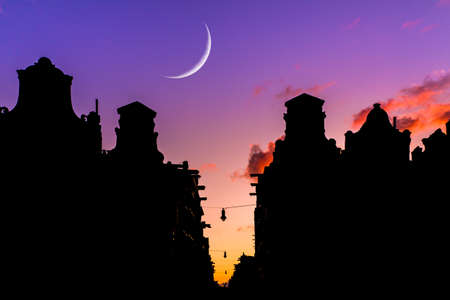 canal houses: Beautiful moon over the canal houses at the little nine streets in Amsterdam, the Netherlands, at sunset