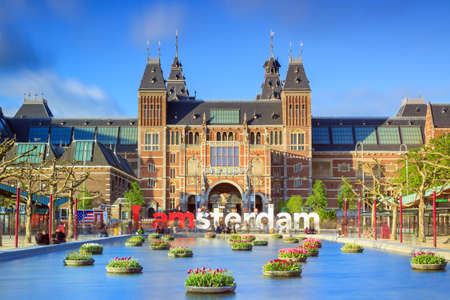 holland: Beautiful vibrant of tulips in the pond in front of the Rijksmuseum National State Museum in Amsterdam in spring Editorial