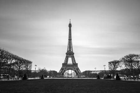 france: Beautiful tranquil long exposure view of the Eiffel tower in Paris, France, in black and white
