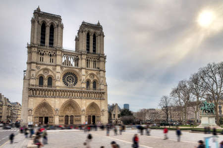 moody sky: Front view of the Notre Dame Cathedral in Paris with a moody sky in winter
