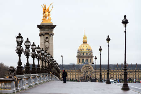 alexandre: A cloudy day at the Pont Alexandre III and Les Invalides in Paris Stock Photo