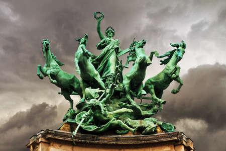 quadriga: Quadriga statue on top of the Grand Palais in Paris. LImmortalite devancant le Temps