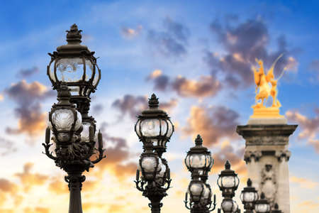 iii: Lanterns of the Pont Alexandre III at sunset in Paris