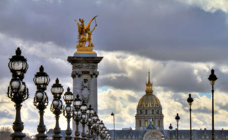 outrageous: Beautiful view from the Pont Alexandre III or Les Invalides in Paris on a cloudy winter day Stock Photo