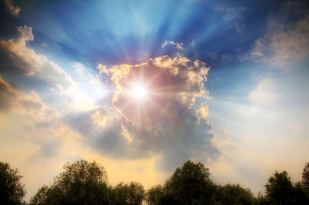 beautiful heaven: Divine light shines through the clouds with crepuscular rays