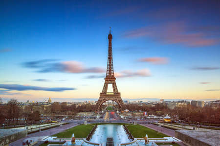 tourist attraction: Beautiful long exposure of the Eiffel tower in Paris, France, at sunset Stock Photo