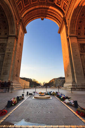 tomb unknown soldier: Beautiful view from under the Arc de Triomphe in Paris, France, with the tomb of the unknown soldier