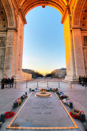 tomb of the unknown soldier: Beautiful view from under the Arc de Triomphe in Paris, France, with the tomb of the unknown soldier