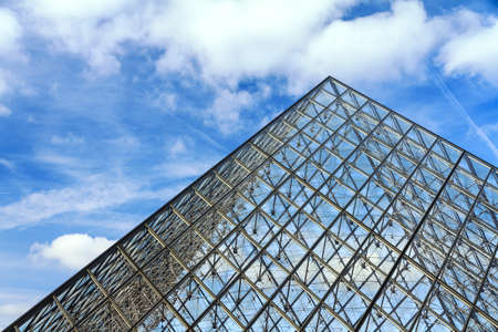 louvre pyramid: Beautiful view of the Louvre pyramid in Paris on a cloudy winter day Editorial