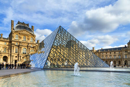 museum visit: Tourists visit the Louvre museum in Paris, France, on February 23, 2014