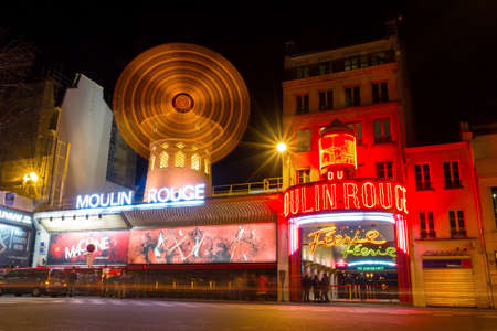 moulin: World famous cabaret club the Moulin Rouge at night in Paris, France, on February 23, 2014