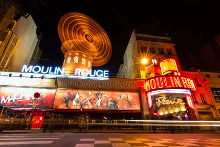 rouge: World famous cabaret club the Moulin Rouge at night in Paris, France, on February 23, 2014