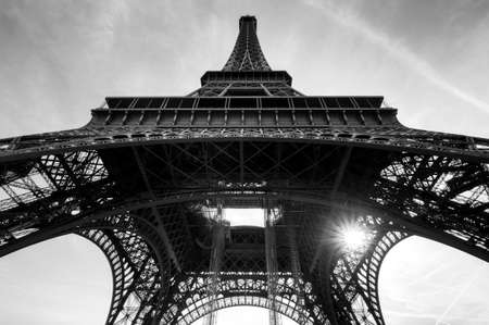 beneath: Beautiful view of the Eiffel tower seen from beneath in Paris in black and white