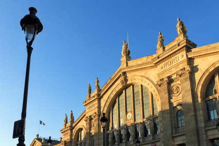 du: Sunset facade of station Gare du Nord in Paris, France
