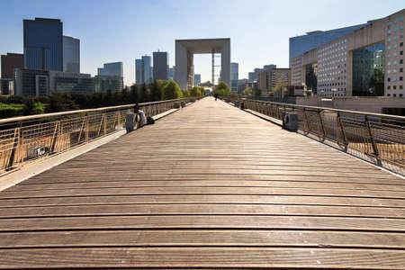 la defense: Beautiful wooden boardwalk at La Defense in Paris, France, with La Grande Arche in the background