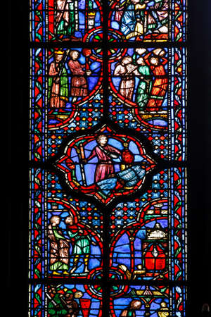 depicting: Beautiful colored ancient stained glass depicting a medieval scene