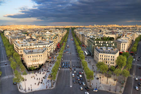 charles de gaulle: View of the Champs-Elysees seen from the Arc de Triomphe in the afternoon in Paris, France