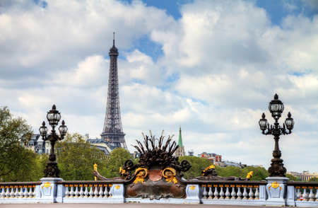 alexandre: The Pont Alexandre III over the river Seine with the Eiffel tower in the background in Paris, France, in spring Stock Photo