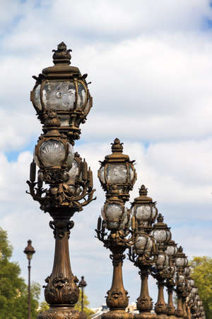 alexandre: Ornate lanterns at the Pont Alexandre III in Paris, France Stock Photo