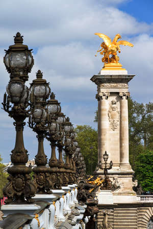alexandre: Ornate lanterns and statue at the Pont Alexandre III in Paris, France