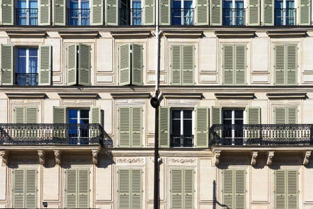 Window and balcony close up of an apartment building in Paris, France 스톡 콘텐츠