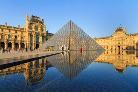 louvre pyramid: The Louvre museum pyramid at sunset in Paris, France, on April 14, 2014 Editorial