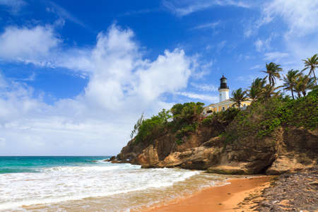 Puerto Rico coastline beach at Punta Tuna lighthouse in summer with a blue sky and clouds 스톡 콘텐츠