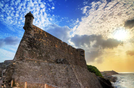 sentry: Beautiful view of the large outer wall with sentry box of fort San Cristobal in San Juan, Puerto Rico