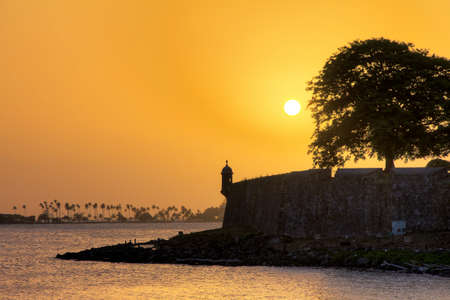Beautiful summer sunset at the outer wall with sentry box of fort San Felipe del Morro in old San Juan in Puerto Rico