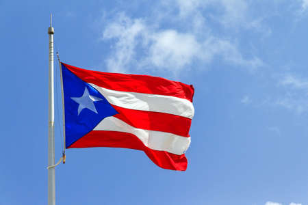 puerto rican: Beautiful Puerto Rican flag against a blue sky Stock Photo