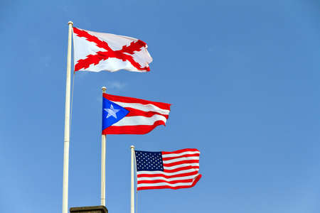 cristobal: Flags of the Old Spanish military (Cross of Burgundy), Puerto Rico and America at fort San Cristobal in San Juan, Puerto Rico