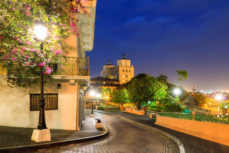 Beautiful summer cityscape of old San Juan, Puerto Rico, at the blue hour at night Фото со стока