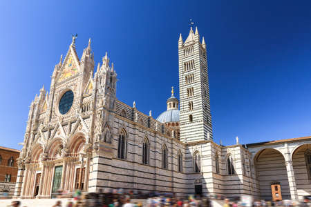 Beautiful cityscape of Siena, Italy, with the Siena Cathedral (Duomo di Siena) with a blue sky in summer Stock Photo
