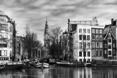 amstel: Beautiful view of the river Amstel and the Groenburgwal with the Zuiderkerk (Southern Church) in Amsterdam, the Netherlands, in black and white.