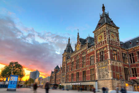 cs: Beautiful view of the historic national monument Amsterdam Central train station, at sunset Stock Photo