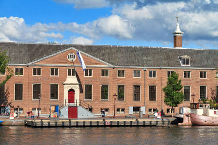 amstel river: Facade of museum the Hermitage at the river Amstel in Amsterdam, the Netherlands, on a sunny summer day, on June 30, 2014 Editorial