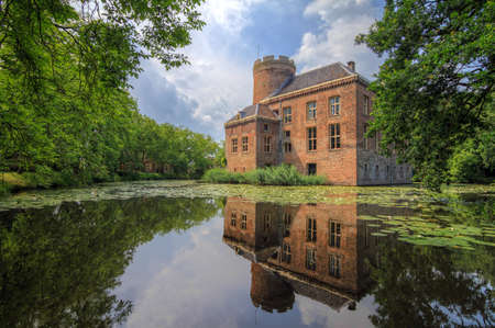 Beautiful view with reflection of castle Loenersloot in the Netherlands in summer Stock Photo