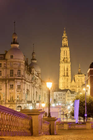 Beautiful view of the Cathedral of Our Lady (Onze-Lieve-Vrouwekathedraal) and a street light lantern at night in Antwerp, Belgium