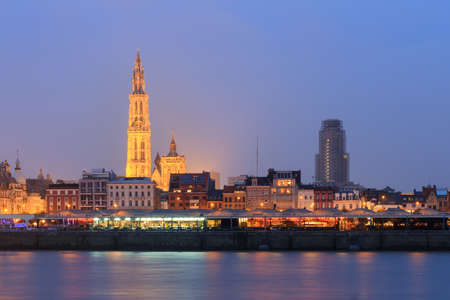 Beautiful cityscape of the skyline of Antwerp, Belgium, during the blue hour seen from the shore of the river Scheldt