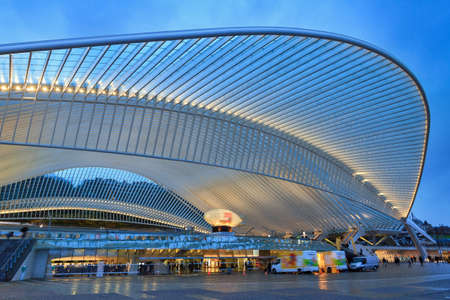Beautiful view of the modern architecture railway station Liege-Guillemins with steel shapes and lines in the blue hour in Belgium