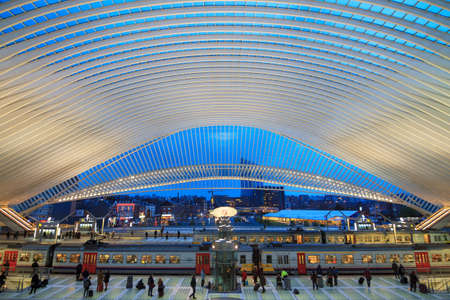 Beautiful interior view of the modern architecture railway station Liege-Guillemins with steel shapes and lines in the blue hour in Belgium