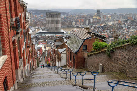 Beautiful cityscape of the 374-step long staircase Montagne de Bueren, a popular landmark and tourist attraction in Liege, Belgium Editorial
